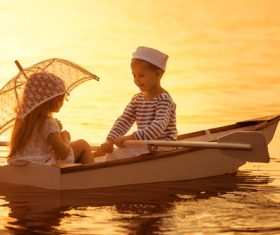 little boy boating on the lake with little girl Stock Photo 04