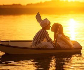 little boy boating on the lake with little girl Stock Photo 05