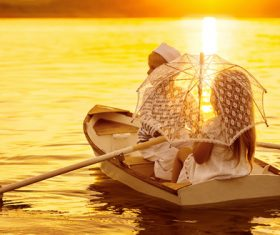 little boy boating on the lake with little girl Stock Photo 07
