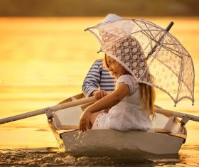 little boy boating on the lake with little girl Stock Photo 10