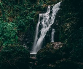 quiet and secluded forest waterfall Stock Photo