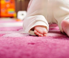 Baby crawling on the carpet Stock Photo