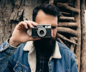 Bearded man with hands shoot camera Stock Photo