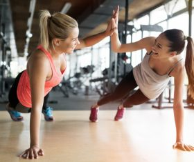Best friend encourages exercise in the gym Stock Photo