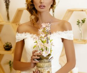 Blonde pretty woman holding flower arrangement Stock Photo 01