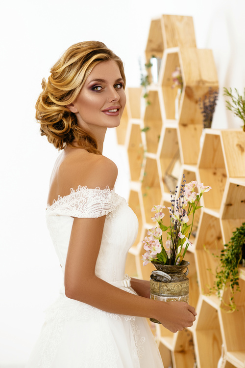 Blonde pretty woman holding flower arrangement Stock Photo 06