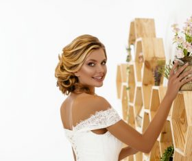 Blonde pretty woman holding flower arrangement Stock Photo 07