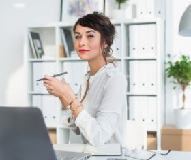 Business woman drinking coffee in the office Stock Photo