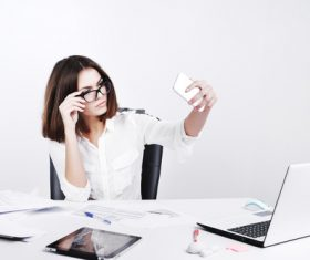 Business woman using cell phone in the office selfie 01