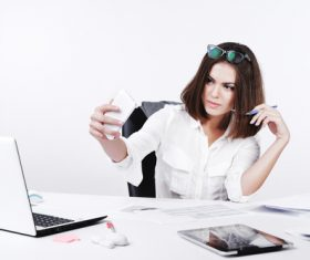 Business woman using cell phone in the office selfie 02