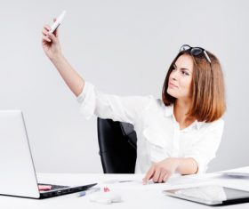 Business woman using cell phone in the office selfie 03