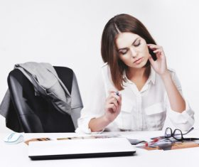 Businesswoman looking at documents on the desk Stock Photo 01
