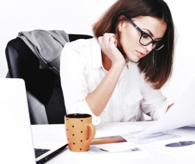 Businesswoman looking at documents on the desk Stock Photo 02