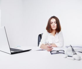 Businesswoman looking at documents on the desk Stock Photo 03