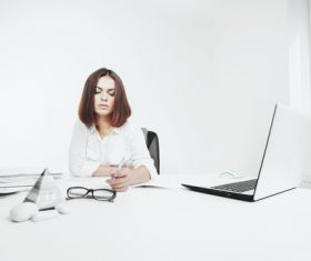 Businesswoman looking at documents on the desk Stock Photo 04