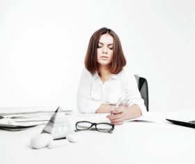 Businesswoman looking at documents on the desk Stock Photo 05