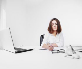 Businesswoman looking at documents on the desk Stock Photo 07