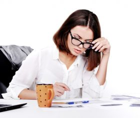 Businesswoman looking at documents on the desk Stock Photo 09