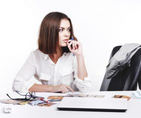 Businesswoman looking at documents on the desk Stock Photo 10