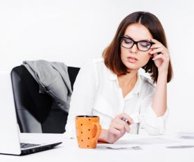 Businesswoman looking at documents on the desk Stock Photo 11
