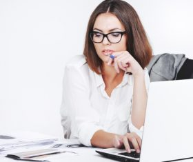 Businesswoman using laptop in office Stock Photo 01