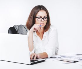 Businesswoman using laptop in office Stock Photo 02