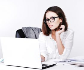 Businesswoman using laptop in office Stock Photo 03