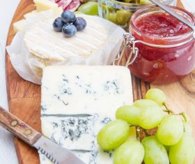 Cheese jam and sausage with pickled olives on cutting board Stock Photo 02