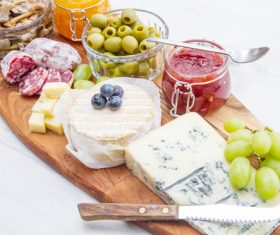 Cheese jam and sausage with pickled olives on cutting board Stock Photo 03