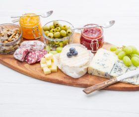 Cheese jam and sausage with pickled olives on cutting board Stock Photo 04
