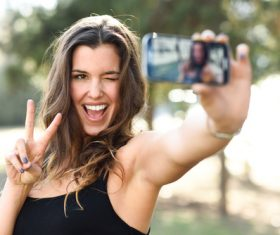 Confident beautiful woman taking a selfie Stock Photo