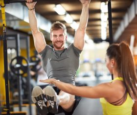 Couple doing sports in the gym Stock Photo 01