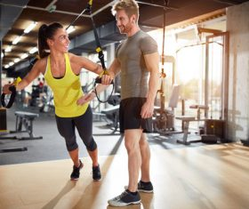 Couple doing sports in the gym Stock Photo 02
