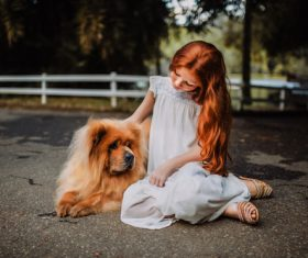 Cute little girl and pet dog Stock Photo