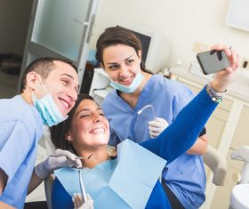 Dental patient and dentist taking pictures Stock Photo