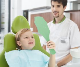 Dentist and child patient Stock Photo