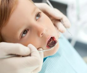 Dentist examines childrens teeth Stock Photo 01