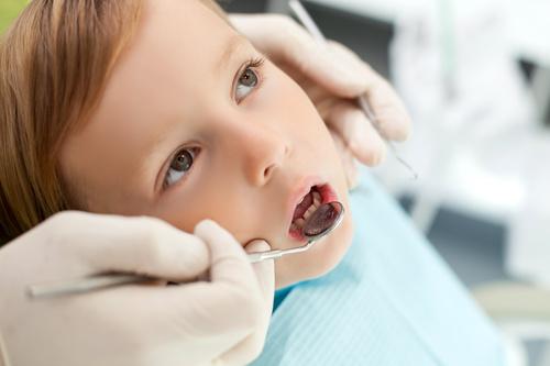 Dentist examines childrens teeth Stock Photo 01