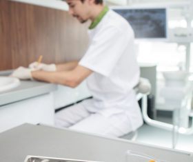 Dentist makes records and dental equipment on the desktop Stock Photo