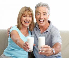 Elderly couple holding milk in hand Stock Photo