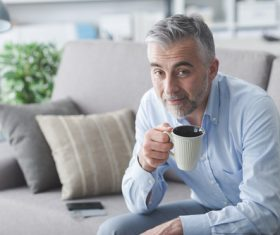 Elderly man drinking coffee Stock Photo