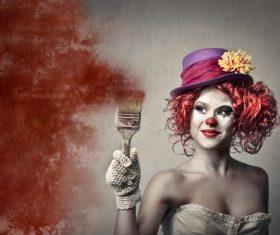 Female clown holding a brush Stock Photo