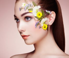 Female model facial flower decoration Stock Photo
