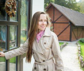 Female opening the door Stock Photo