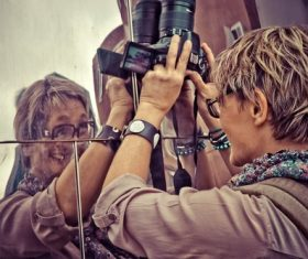 Female photographer framing Stock Photo
