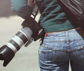 Female photographer waist camera Stock Photo