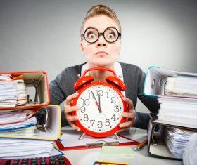 Female secretary and alarm clock Stock Photo 02