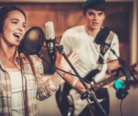 Female singer recording in the recording studio Stock Photo
