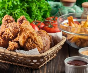 Fried chicken legs and fried potatoes Stock Photo