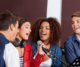 Friends gather together to sing Stock Photo